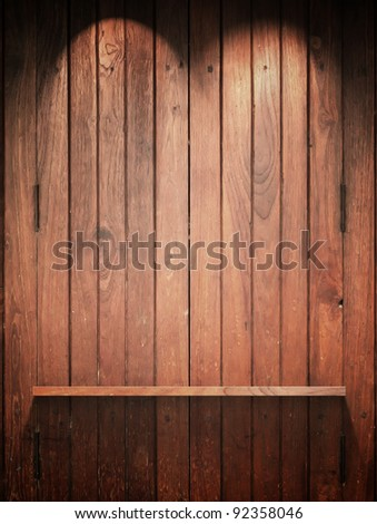 Empty Wood Shelf on wall with Top light and shadow