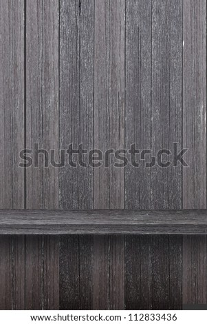 Empty wood shelf on wood wall