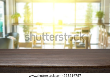 Empty wood table and blurred cafe light background. product display template. Business presentation