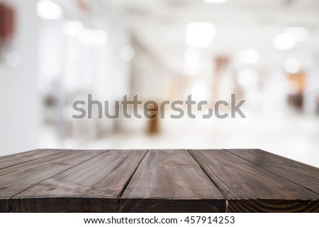empty wood table and blurred...