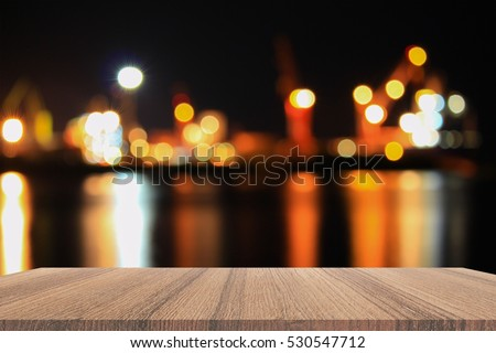 Empty wood table and night light bokeh for Christmas  New Year background. with copy space  add text #530547712