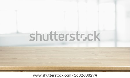 Empty Wood table on blur kitchen window background for panoramic banner