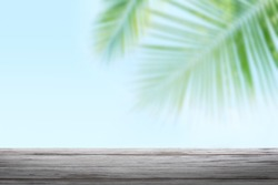 empty wood table on coconut tree blur, background coconut and wood plank, coconut palm tree background blurred and slats wooden texture floor, wood plank table empty over coconut tree nature