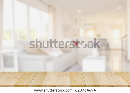 Empty wood table space platform and living room background.  Product display montage Concept.  #620764694