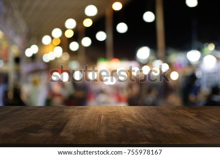 Empty wood table top and blur of night market background/selective focus .For montage product display #755978167