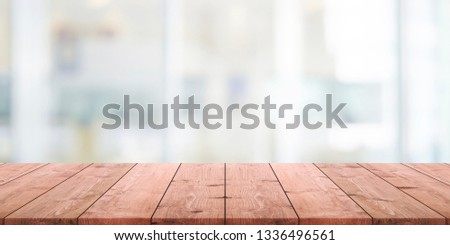 Empty wood table top and blurred abstract restaurant interior background - can used for display or montage your products. #1336496561