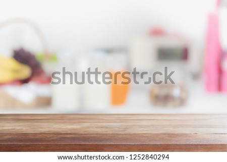 Empty wood table top and blurred kitchen interior background - can used for display or montage your products. #1252840294