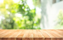 Empty wood table top on blur abstract green from garden and home area background.For montage product display or design key visual layout