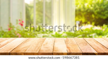Empty wood table top on blur abstract green from garden and house in morning background.For montage product display or design key visual layout #598667381