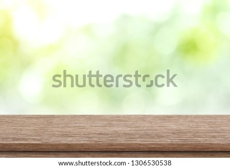 Empty wood table top on blur green from garden background, Template mock up for display of product