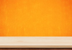 Empty wood table top on orange concrete background, Template mock up for display of product.