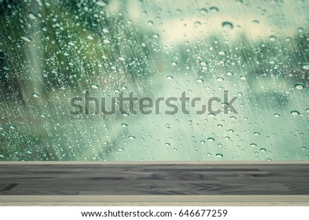 empty wood table with rain drop window background