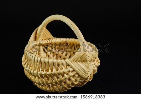 Photo of  Empty wooden basket on black background