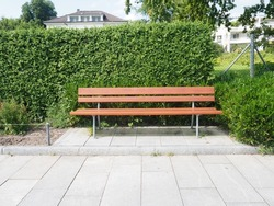 Empty wooden bench in a park