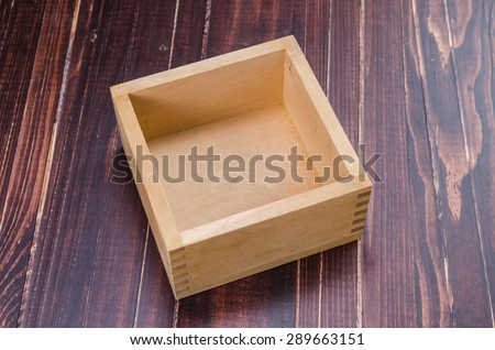 empty wooden box on wooden board background