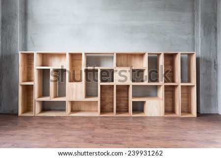 Empty wooden boxes on the ground in a room.