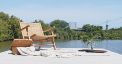 empty wooden chair for relaxation on the terrace balcony during a tropical sunny bright day in summertime, leisure chillout zone at lake side waterfront enjoy lifestyle vacation holiday nature