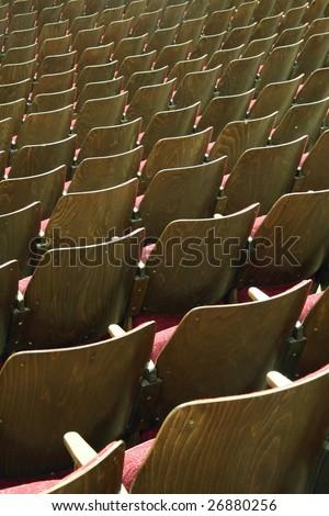 empty wooden cinema or theatre seats, vertical photo