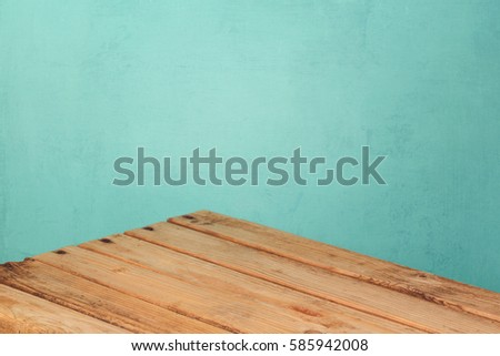 Empty wooden corner table over mint wall background for product montage display #585942008