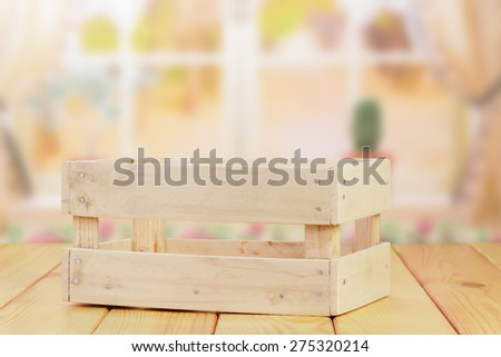 Empty wooden crate on table