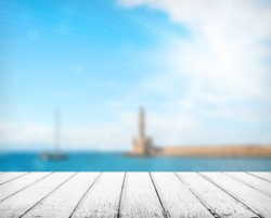 Empty wooden deck table with copyspace and bokeh background.