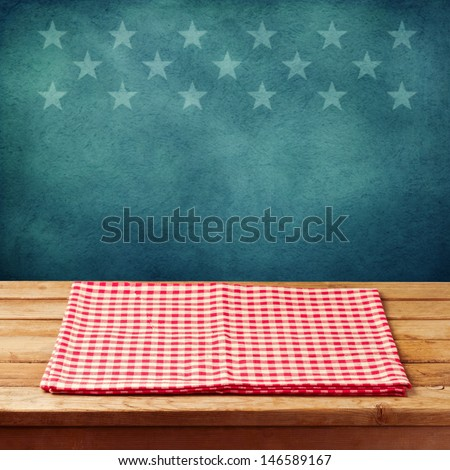 Empty wooden deck table with tablecloth for USA holidays background. Ready for product display montage