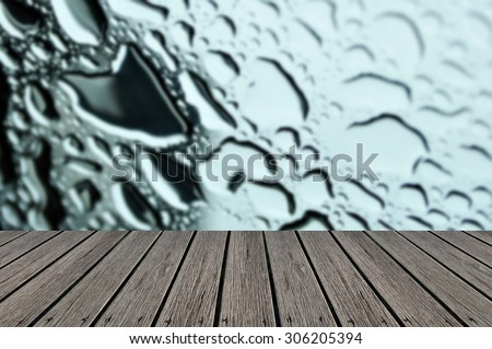 Empty wooden deck table with Water drops on metal surface. Abstract background