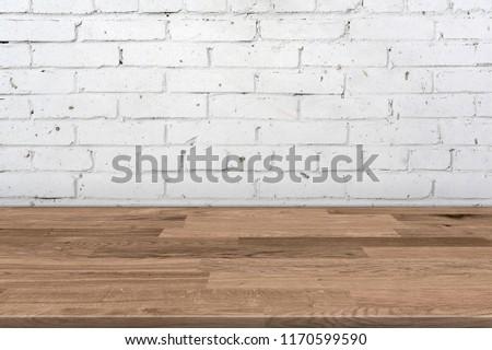 Empty wooden desk table near a textured wall, 3d illustration