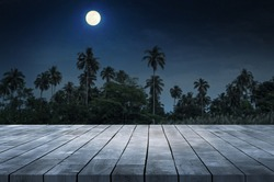 Empty Wooden Desk with Romantic Dark Night atmosphere with coconut forest and Beautiful  full moon
