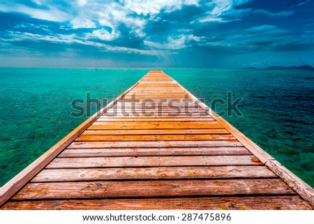 Empty Wooden Dock Over Tropical Blue Water