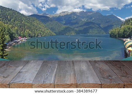 Empty wooden flooring against Rits's lake in mountains in Abkhazia.                             #384389677