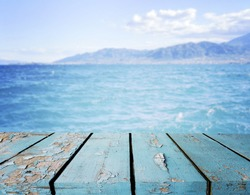 Empty wooden planks  with  blue sea blue sky at background, product presintation