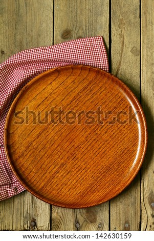 empty wooden plate on the old wooden table