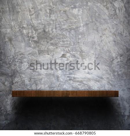empty wooden shelf on old grey...