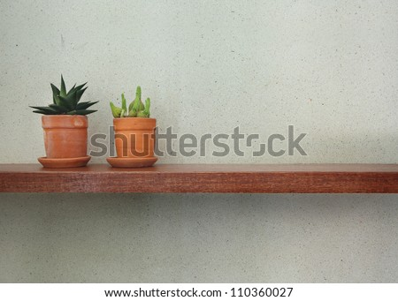 Empty wooden shelf on the tile wall. - stock photo