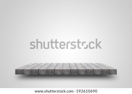 Empty wooden shelf on white background. For display or montage your products with focus wooden shelf top in the foreground