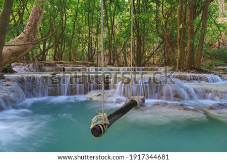 empty wooden swing in beautiful nature with Waterfall in forest at Wang Kan Luang Waterfall for relaxation natural therapy, Lopburi province Thailand. Stockfoto ©
