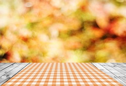 Empty wooden table and autumn background