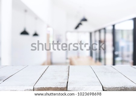 Empty wooden table and blurred background of abstract in front of restaurant or coffee shop for display of product or for montage. #1023698698