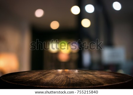 Empty wooden table and blurred background of abstract in front of restaurant or coffee shop for display of product or for montage.
