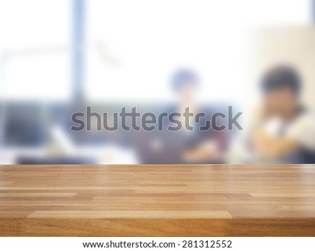 Empty wooden table and blurred business people background,product display