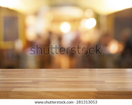 Empty wooden table and blurred cafe background, product display #281313053