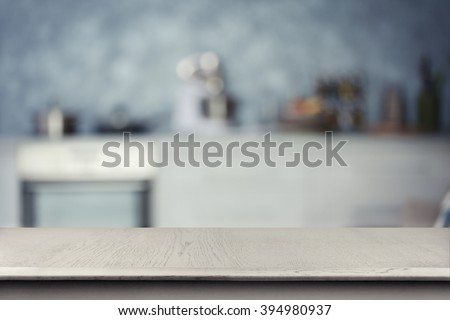 Empty wooden table and blurred kitchen background