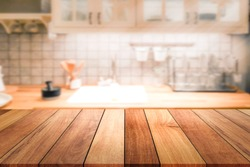 Empty wooden table and blurred kitchen background for display or montage your products