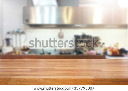 Empty wooden table and blurred kitchen background, product montage display