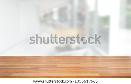 Empty wooden table and blurred modern white abstract background, Ready for product montage, indoor and window #1355619665