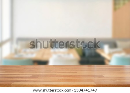 Empty wooden table and blurred modern white kitchen coffee cafe background, restaurants. Ready for product montage, bokeh , light #1304741749