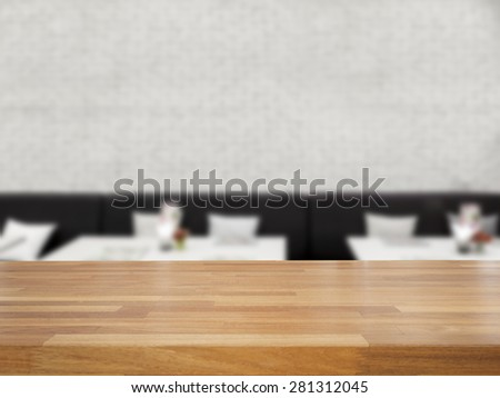 Empty wooden table and blurred white brick wall and chair background,product display