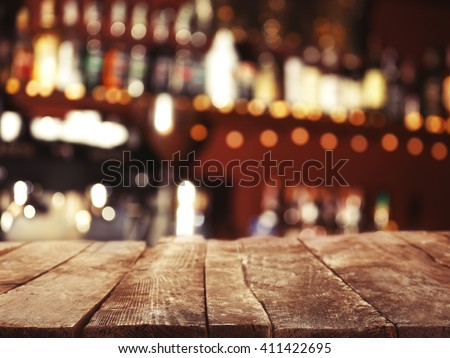 empty wooden table and bokeh...
