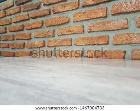 Empty wooden table and Brick  block background with space.Empty for product display. Ready for product display montage. Fair in blurred and de-focus, Soft focus,Select focus